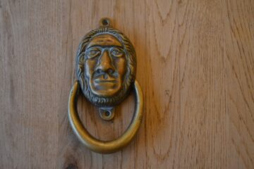 Antique Prehistoric Man Door Knocker D411-1219 Antique Door Knocker Company
